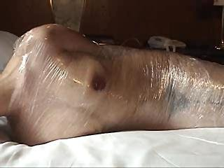 Japan Girl Wrapped In Plastic And Masturbation Vacuum Play