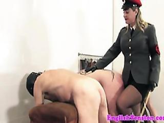 Mature Dominatrix Flogging Her Submissive Asses