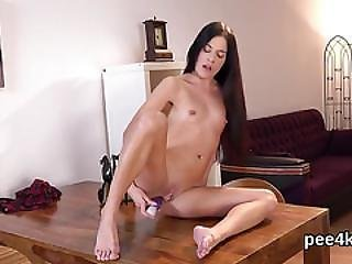 Glamorous Sweetie Is Pissing And Masturbating Shaved Snatch
