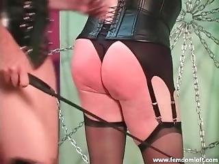Sexy Mistress In Lingerie And Stockings Using Her Crop To Punish A Slave