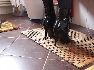 Women Wearing Black High Heels Boots