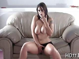 Busty Brunette Undressing Softly