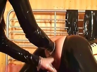 Latex Mistress Fisting A Girl Slave