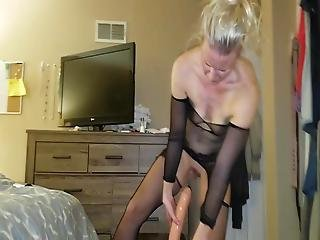 Amateur Blonde Milf Slides On Huge Dildo