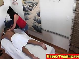 Asian Masseuse Tugging And Riding Dick