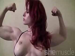 Muscular Redhead Andrea Rosu Stretches Out