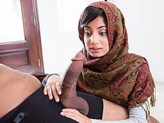 Arab Babe Flirts With Her New Neighbor To Suck His Black Dick