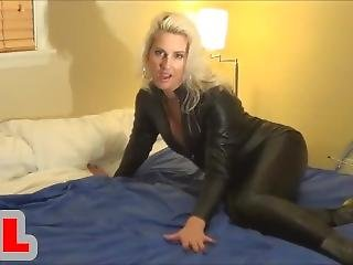 Blonde In Leather Catsuit Wank Her Husband On Bed