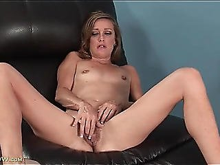 Slim Aged Whore Plays With Her Bushy Muff
