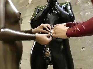 Two Latex Catsuit Girl Bondage And Ball Gagged