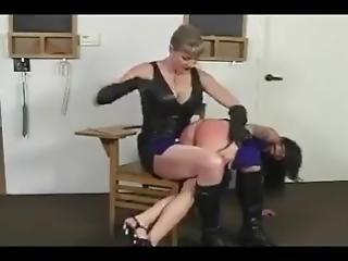 Asian girl giving boy spanking