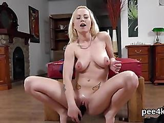 Attractive Chick Is Pissing And Pleasuring Hairless Cunt