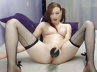Cheerful Doll Barbarously Masturbates With A Big Black