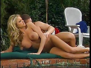 Busty Blonde Gets Fucked At The Pool