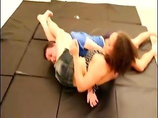 Tough Girl Wrestling Her Opponent