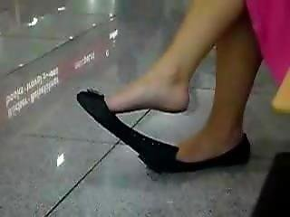 Candid Dangling In Black Flats