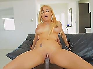 Spectacular Blonde Slut Riding A Big Black Cock On A Leather Sofa