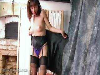 Watch As Hot Milf Cindy Strips Off Her Soft Black Leather Outfit To Reveal Her Sexy Thong Nylons Corset And High Heels