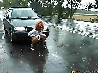 He Sat Down On The Road Behind The Car Pissing
