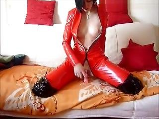 German Amateur Lady Masturbates Herself In Red Pvc Catsuit.
