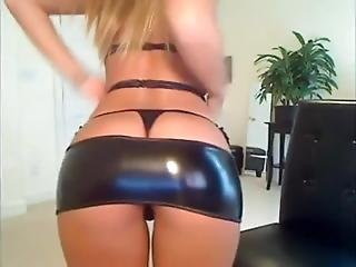 Busty Blond Showing Her Boobs In A Latex Dress
