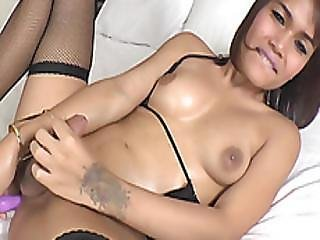 Thai Ladyboy Jakki Dildoing Her Asshole While Masturbating