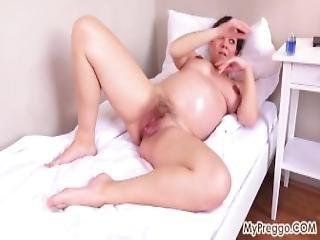 Pregnant Corazon Oiled Up And Masturbating