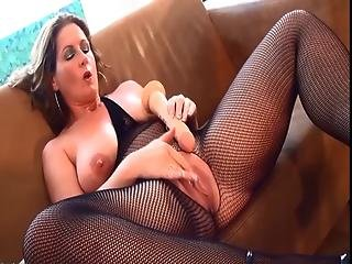 Manuela Playing With A Dildo