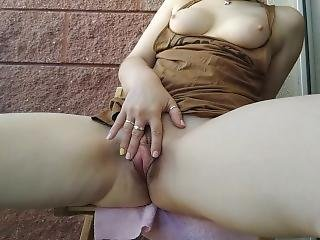 Young Hairy Pussy Exhibitionist Pisses On The Balcony Like A Fountain