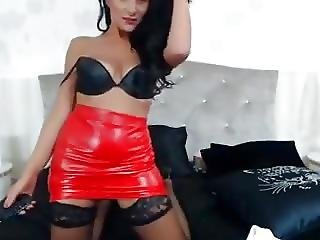 Raven Haired Milf Teases In Red Leather Dress