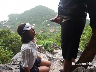 Blowjob And Piss Drinking Under The Rain