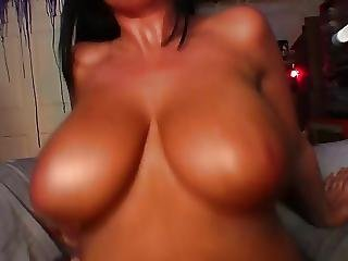 Tanned Brunette With Amazing Tits Rides Black Cock On The Sofa