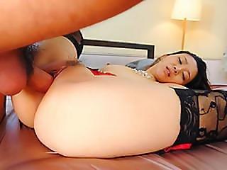 Minako Uchida Looks Dashing With Two Coks In Her