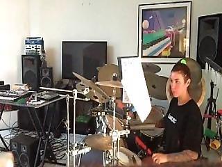 Felicity Feline Practices Her Drums Behind The Scenes