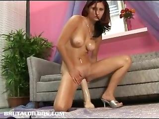Amateur Redhead Punishes Her Pussy With A Massive Dildo