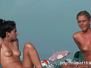 Shaved Pussy Spread On The Beach Hidden Camera Nudist Video