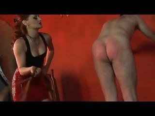 Domme In Latex Whipping A Slave