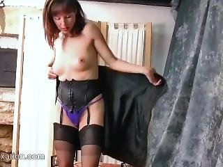 Hot Milf Strips Off Leather Outfit To Reveal Thong Nylons Corset High Heels