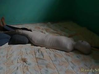 Indonesian Girl Wrapped Mummification With Training Costume