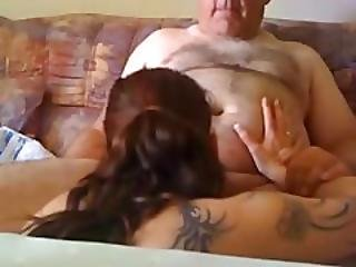 Young Girl Blows An Older Man