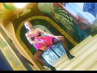 Masturbating Blonde In A Latex Skirt Nylons And Boots