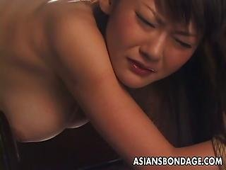 Asian Sex Slave Gets An Enema And Pees