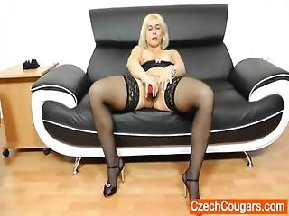 Sandy Pleasing Her Ragged Muff On The Couch