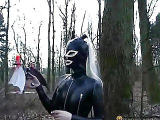 The Girl In Latex Walks In The Woods