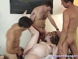 Pregnant Slut Handling Three Dicks