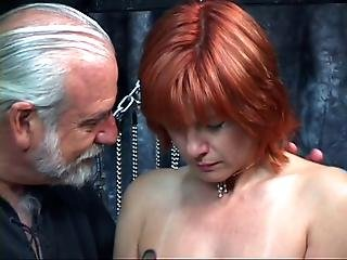 Mature Redheaded Slave With Saggy Tits Is Whipped In Hippy S Basement
