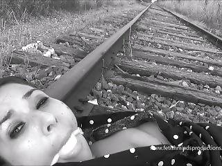 Lady In The Polka Dot Dress Is Tied To The Tracks