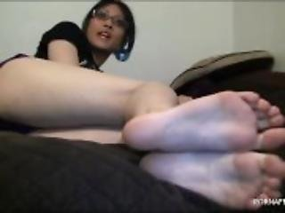 Big bare soles in your face