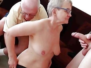 Granny And Husband Invite A Young Stud To Fuck Her