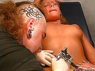 A Guy Makes A Tattoo On The Body Crumbs